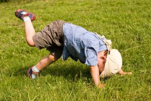 Running boy fall down in park
