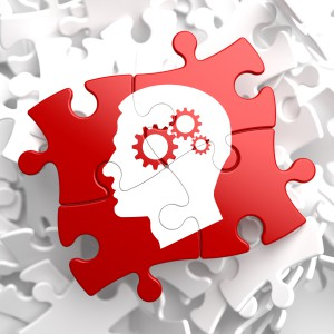 Psychological Concept - Profile of Head with Cogwheel Gear Mechanism Located on Red Puzzle.